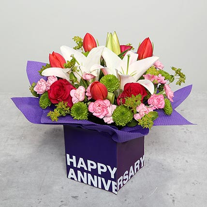 Tulips Roses and Carnations in Glass Vase: Anniversary Flowers Singapore