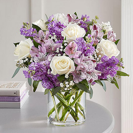 Purple And White Floral Bunch In Glass Vase: Anniversary Gift Ideas For Her