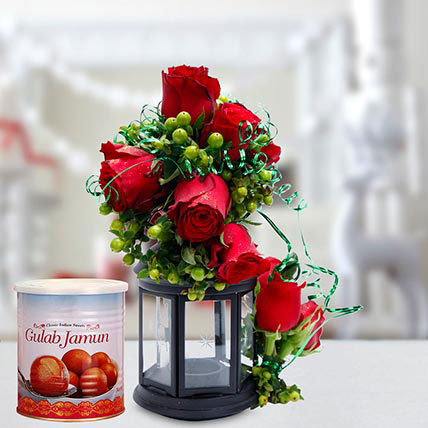 Alluring Roses Arrangement and Gulab Jamun Combo: Table Flower Arrangement