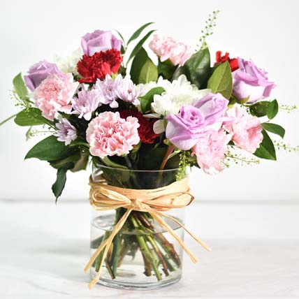 Mixed Flowers In Round Glass Box: Women's Day Gifts