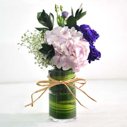 Beautiful Mixed Flowers In Round Glass Vase: Women's Day Flowers