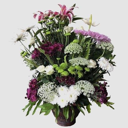 Premium Mixed Flowers In Glass Vase