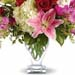 Bunch of Warm Flowers In Glass Vase