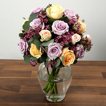 Mixed Rose and Wax Flower Arrangement In Glass Vase