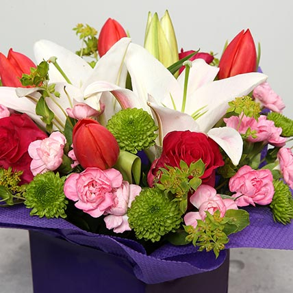Tulips Roses and Carnations in Glass Vase