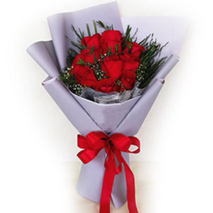 Bouquet of Red Roses In Purple Wrapped Paper
